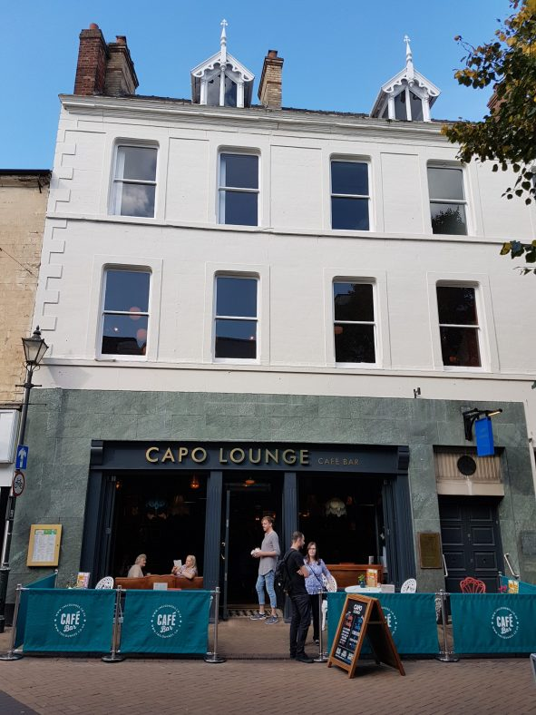 2-8 Stockwell Gate. View of Capo Lounge cafe bar with two white painted storeys above.