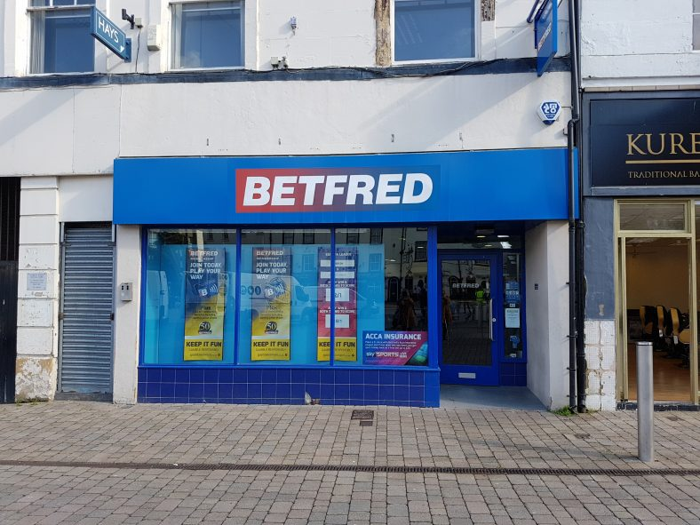 View of a 20th century timber shop front currently occupied by BETFRED bookmakers.