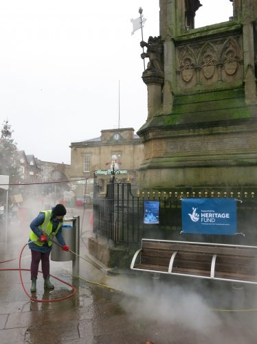 Steam-cleaning the Bentinck Memorial in 2019