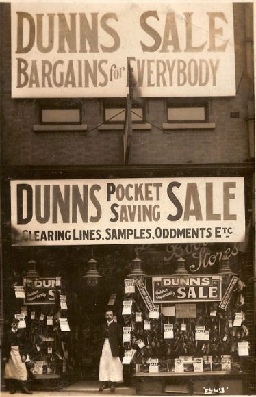 Old sepia photo of Dunns, boot shop, at 12 Leeming Street in the 1900s | Courtesy of D. Hill
