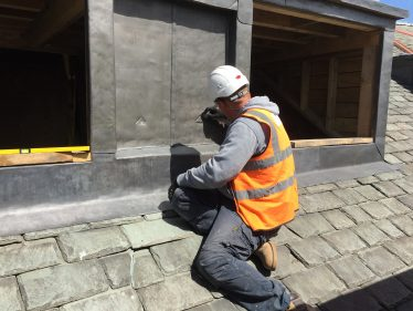 Worker fitting lead flashing around windows | Pete Brown