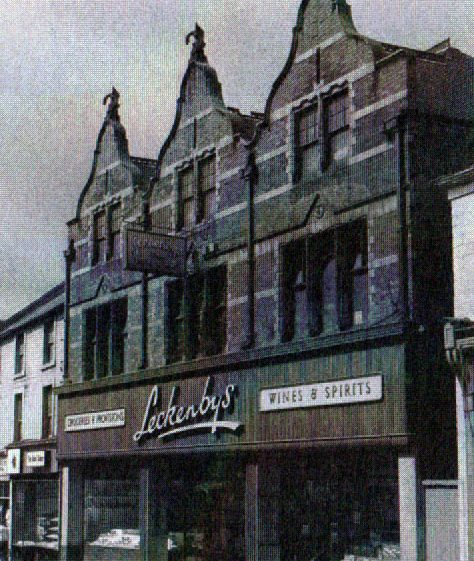 Old black and white photo of Leckenby's, food store, with full gables at 23-27 Leeming Street in 1950 | Courtesy of D. Hill