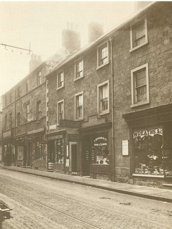 Old sepia photo of Leeming Street shops in the 1900s