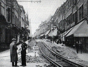 Old black and white photo of tram tracks being laid on Leeming Street in the 1900s | Courtesy of D. Hill