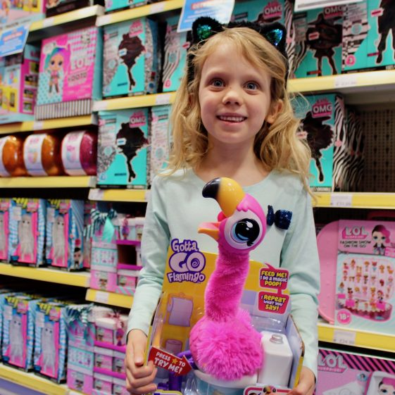 First prize winner, Chloe Daykin, at Smyths Toys claiming her flamingo