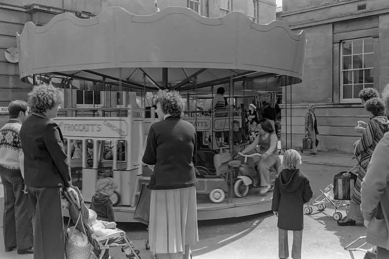 Families enjoying the merry-go-round in Mansfield Market Place 1970s | Keith Streb